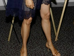 Various pictures of the lovely legs and feet of Famke Janssen