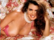Ultra popular Brooke Shields showing her big set of titties and round butt while on her bed